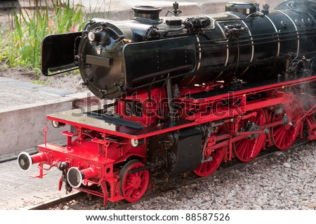 perfect black and red model steam locomotive - stock photo