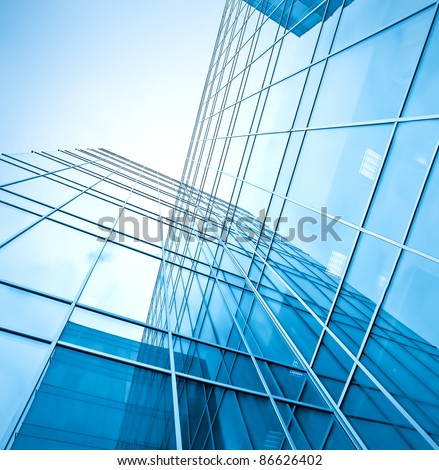 perfect blue glass high-rise corporate building - stock photo