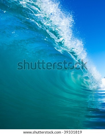 Perfect Blue Surfing Wave breaks in Tropical Ocean - stock photo
