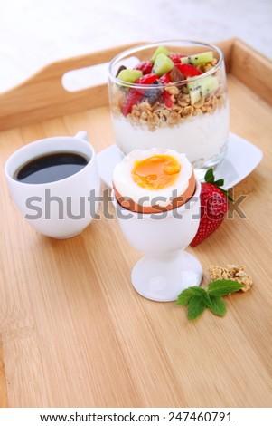 Perfect breakfast: fresh yogurt with fruits and granola  - stock photo