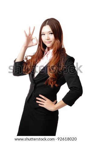 Perfect - business woman showing OK hand sign isolated on white background. Young pretty Asian businesswoman - stock photo