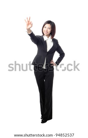Perfect - business woman showing OK hand sign smiling happy. Young pretty Asian businesswoman isolated on white background. - stock photo