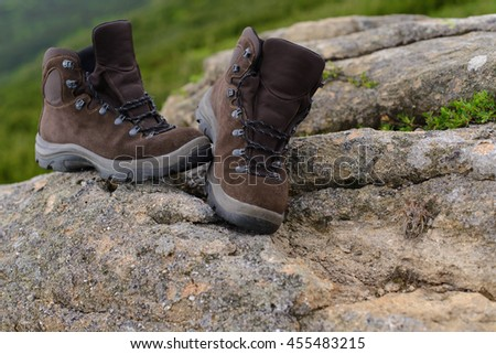 Perfect camping. Close up of boots in mountains. Camping equipment footwear concept