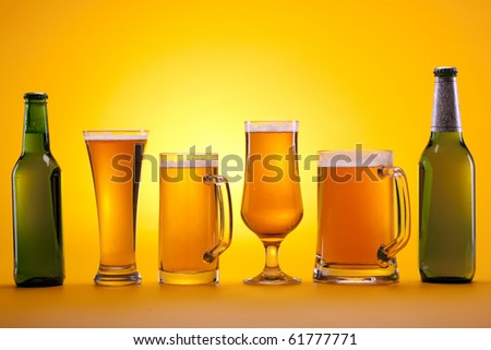 Perfect chilled beer on yellow background - stock photo