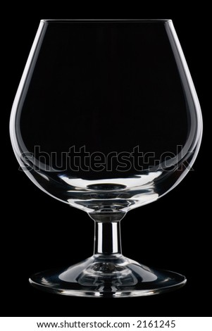 Perfect, clean, cognac glass against a black background - stock photo