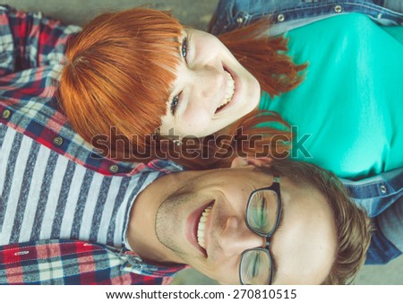 perfect couple. young couple fine portrait from above. concept about expression, happiness, love, couples and people - stock photo