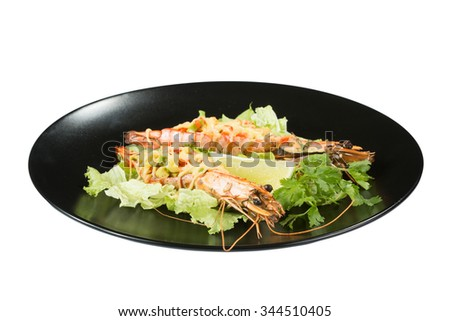 perfect dish with shrimps on a black plate. seafood - stock photo