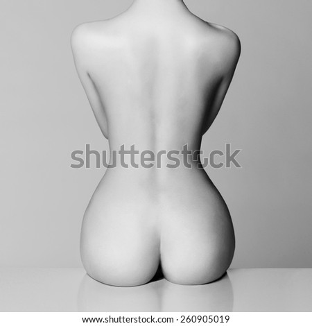 perfect female body with beautiful nude booty - stock photo
