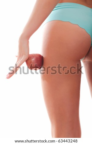 Perfect female figure and red apple. Isolated over a white background. - stock photo