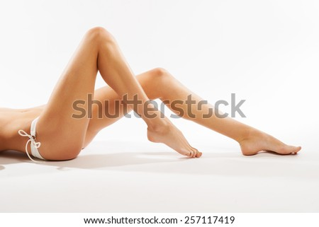 Perfect female legs, isolated on white background - stock photo