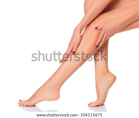 Perfect female legs on white background - stock photo