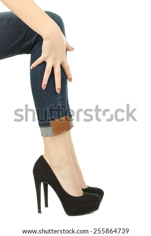 Perfect female legs wearing high heels isolated on white background.