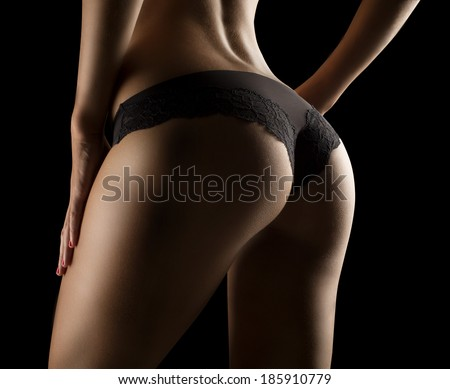 PERFECT female SEXY BUTTOCKS IN BLACK LINGERIE - stock photo