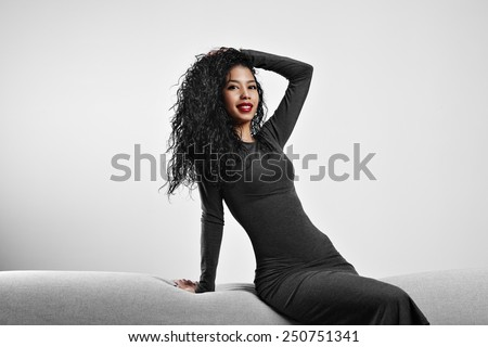 perfect fit black woman with a curly hair and red lips - stock photo