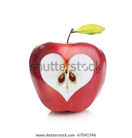 Perfect fresh red apple with a heart shaped cut-out on white background - stock photo