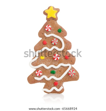 Perfect ginger bread Christmas cookie shaped as a Christmas tree - stock photo