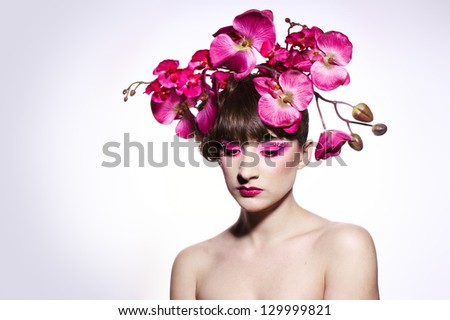Perfect girl with orchid in her hair