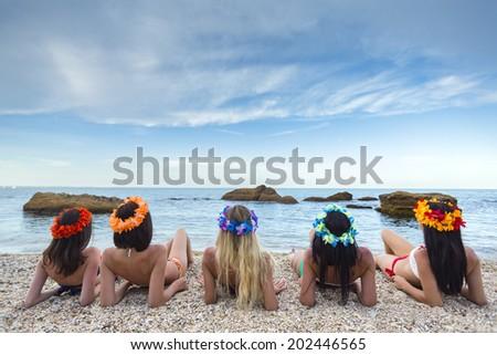 perfect  girls enjoying sunbathing on the beach - stock photo