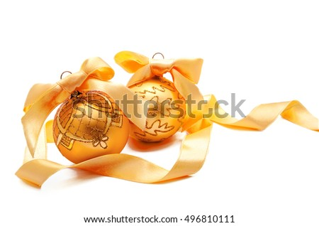 Perfect golden christmas balls with ribbon isolated on a white