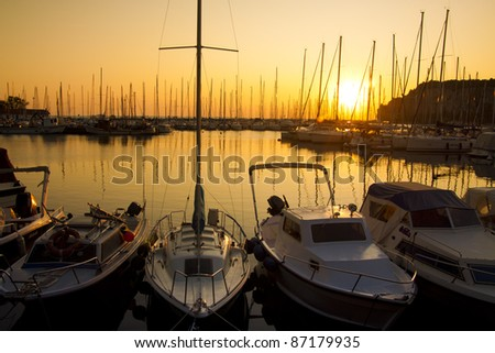 Perfect golden sunset over the sailing boats marine in Sistiana, Italy - stock photo
