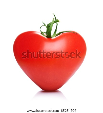 Perfect heart shaped organic tomato on white background (healthy heart, diet, love concept and more) - stock photo