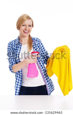 Perfect housewife cleaning the stain with shirts - stock photo