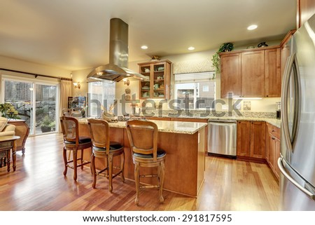 Perfect kitchen with hardwood floor and marble counters. - stock photo