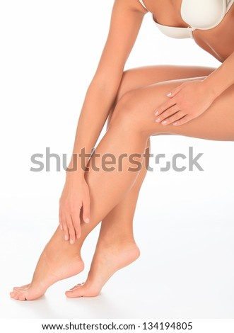 Perfect long female legs against white background. - stock photo
