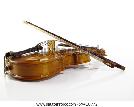 Perfect miniature violin on a white reflective background - stock photo