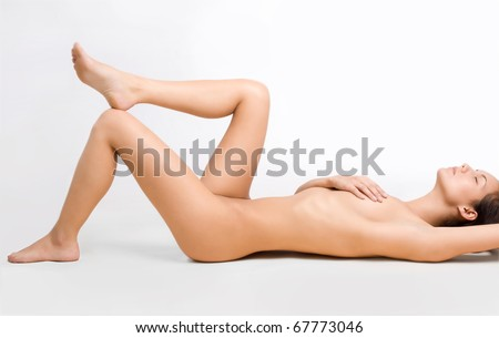 Perfect naked lady lying on the floor - stock photo