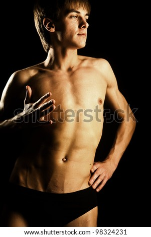 perfect naked male person in small black underwear - stock photo