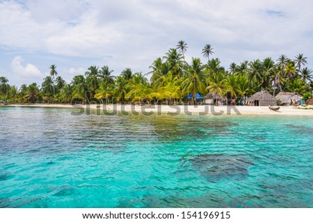 Perfect native caribbean village on crystal clear island. San Blas, Panama. Central America. Latin American Culture. - stock photo