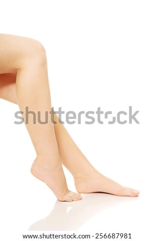 Perfect nude slim female legs