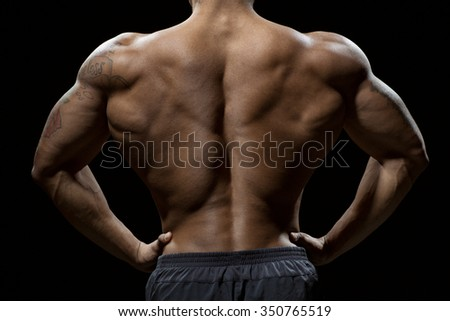 Perfect physique. Cropped shot of a muscular back of a toned male model - stock photo