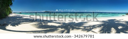 Perfect sandy beach with blue sky and shadow of trees, beautiful place for holiday and relax / outdoors photography of picturesque Seychelle islands - stock photo