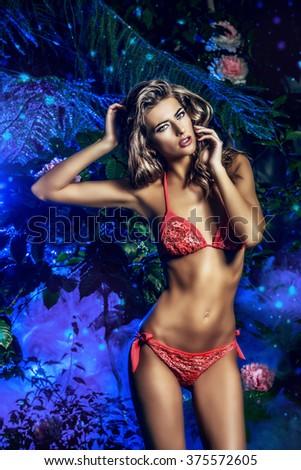 Perfect sexual woman in bikini among tropical plants. Beauty, fashion. Spa, healthcare. Summer vacation. - stock photo
