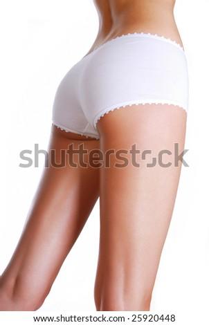 Perfect shape of woman's buttocks - studio shot on white - stock photo