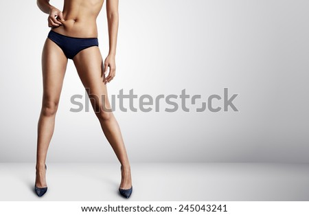 perfect shaped woman pinched her abdomen - stock photo