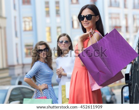 Perfect shopping with a smile. Portrait of  young pretty stylish girl holding the stylish fashionable bag and looking forward in a good mood. Ideal shopping. Mall sales and festive dress shop