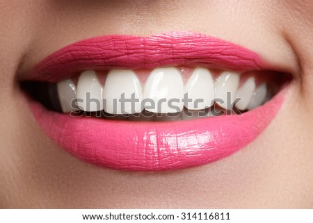 Perfect smile after bleaching. Dental care and whitening teeth. Woman smile with great teeth. Close-up of smile with white healthy teeth