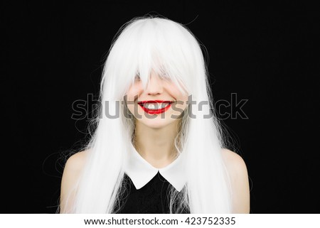 Perfect smile crazy woman in white wig with red lips. Fun girl with white beautiful teeth, school teacher style. Young cheerful girl having fun. Bright makeup and hairstyle black isolated background. - stock photo