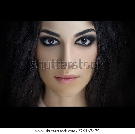 Perfect smoky eyes, professional make-up. Square photo, free black space for text. Portrait of brunette girl with thick curly hair, best model agency, makeup studio, visage master. new fashion trends - stock photo