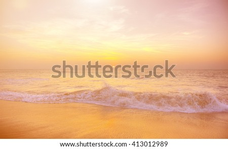 Perfect sunset on a tropical beach. - stock photo