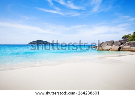 perfect tropical paradise beach with white sand and blue turquoise water - stock photo