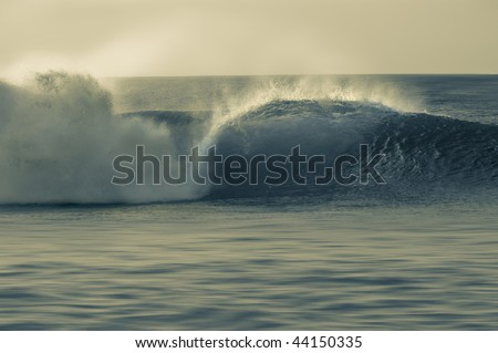 Perfect wave breaking on the shore. Pipeline in the North Shore of Oahu, Hawaii. Split tone. - stock photo