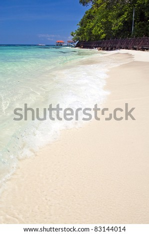 Perfect white sand beach in paradise location - stock photo