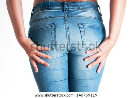 Perfect woman body in blue jeans isolated on white background. - stock photo
