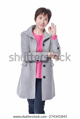 Perfect -  woman showing OK hand sign smiling happy.  - stock photo