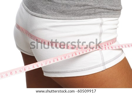 perfect womans bum  measure  by metre-stick - stock photo