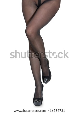 Perfect women's legs in black tights and  shoes isolated on white background - stock photo
